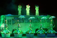 Scene from outside of the bus, with green lighting and cupcake costumes.